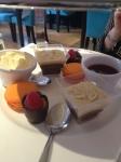 Sweet treats - 'mango' macaron, chocolate pots and chocolate, custard and fruit tartlet bites